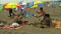 Arena caliente para curar enfermedades, la popular terapia en una playa china