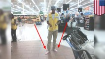 Wal-Mart employee gives homeless man shoes off his feet, works in socks