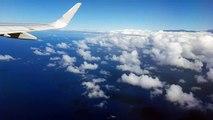 American Airline Flight 212 above Maui, Hawaii with Haleakala Volcano on the Horizon