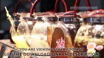 Rack focus shot of decorative glass teapots, variety of herbal tea at festival. Stock Footage