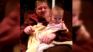 Baby Won't Let Go Of Dad's Phone