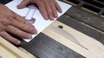 Un charpentier coupe du bois à l'aide d'un disque de papier