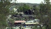 Neuf arrestations après l'incendie au camp de migrants de Lesbos