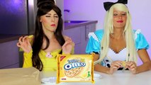 Belle vs Alice Oreo Challenge Battle. DisneyToysFan.