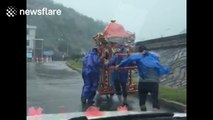 Couples in China press ahead with rainy weddings despite Typhoon Megi