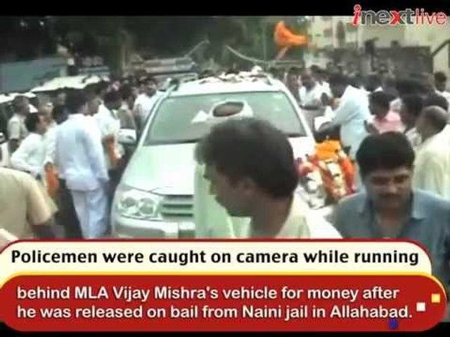 Watch policemen running after MLA's vehicle for money