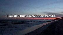 UFO HOVERS AMONGST PLANES