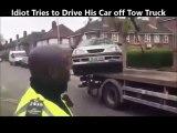 Ce débile essaie de sortir sa voiture de ce camion de la fourrière