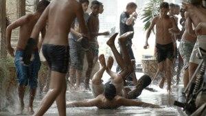 Sidewalk rain surfing, Cuban style