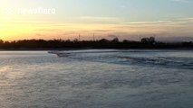 Surfers ride Severn bore in Newnham-on-Severn
