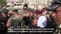 Iraqis in liberated Mosul district wave white flags