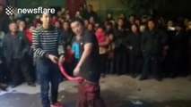 Chinese man puts one-metre-long firecracker between his legs and lights it