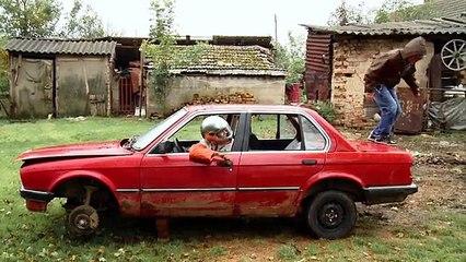 A close-up portrait of a rebellious racecar-driving teen