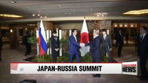 Putin, Abe vow cooperation over islands disputed since World War II