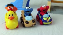 Sesame Street Racers at Bert and Ernie Garage with Cookie Monster and Elmo Racing a Disney Cars Toy
