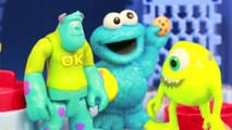 Cookie Monster visits MONSTERS INC & Scare Floor Mike Sully Disney Ariel Frozen Elsa AllToyCollector