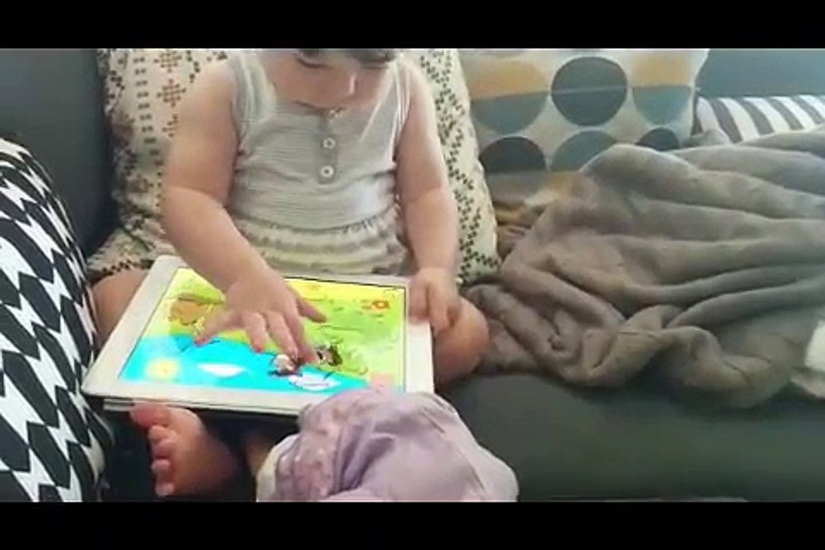 Cute kid playing Kids 1st Puzzles game