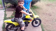 Little kid runs staight into fence with dirt bike-dyup0a8Jdh8