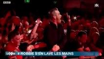 La réaction de Robbie Williams après avoir touché les mains de ses fans fait le buzz ! Regardez
