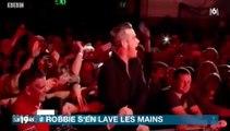 La réaction de Robbie Williams après avoir touché les mains de ses fans fait le buzz !