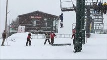 Boy dangles from ski lift after backpack gets stuck