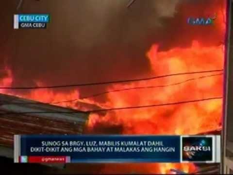Saksi: Sunog sa Brgy  Luz, Cebu City, mabilis kumalat dahil dikit-dikit ang  mga bahay (051112)