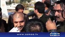 People taking selfies with Imran Khan outside Supreme Court police officials also take selfies.