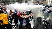 Anti-Maduro protesters clash with Venezuela police after government blocks opposition march