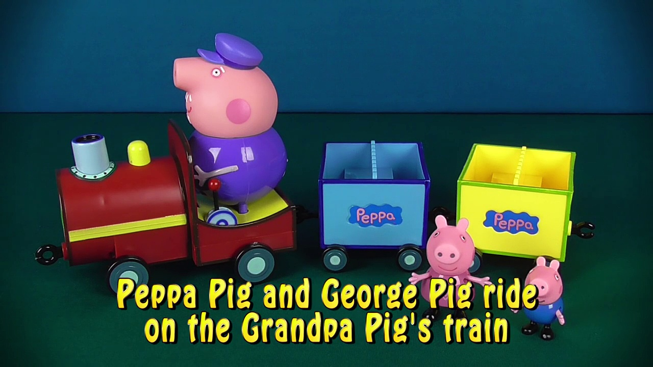 Peppa Pig and George Pig ride on the Grandpa Pigs train