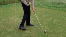 How to initiate the downswing with the left hip bumping