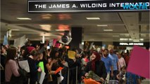 Demonstrators Welcome Immigrants At Washington Dulles Airport