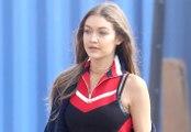 Gigi Hadid Bares Teeny-Tiny Waist In TommyLand Fashion Show