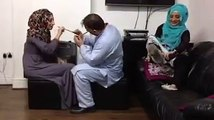 Funny prank Two muslims Girls vs Man     hitting on head By wooden Spoons   Cheated prank