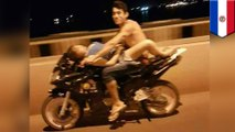 Couple filmed riding each other while riding a motorcycle