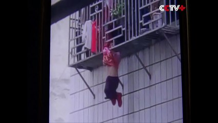 Two Men Save Girl Hanging by Neck From Fourth Story Window