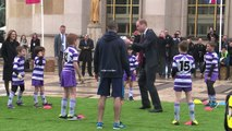 Kate and William play rugby in front of Paris' Eiffel Tower