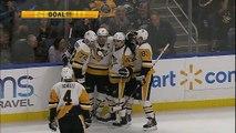 Hockey sur glace - À une main, Sidney Crosby s'amuse face à la défense de Buffalo
