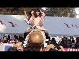 Phallus Parade: Newlyweds ride giant wooden penis at Japanese fertility festival
