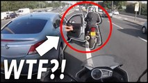 Angry driver hits motorcyclist with car door in road rage