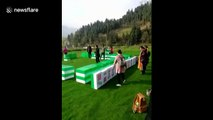 Chinese people play giant mahjong in tourist attraction