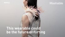 Don't know who's hitting on you? This funky shoulder pad-like wearable will help