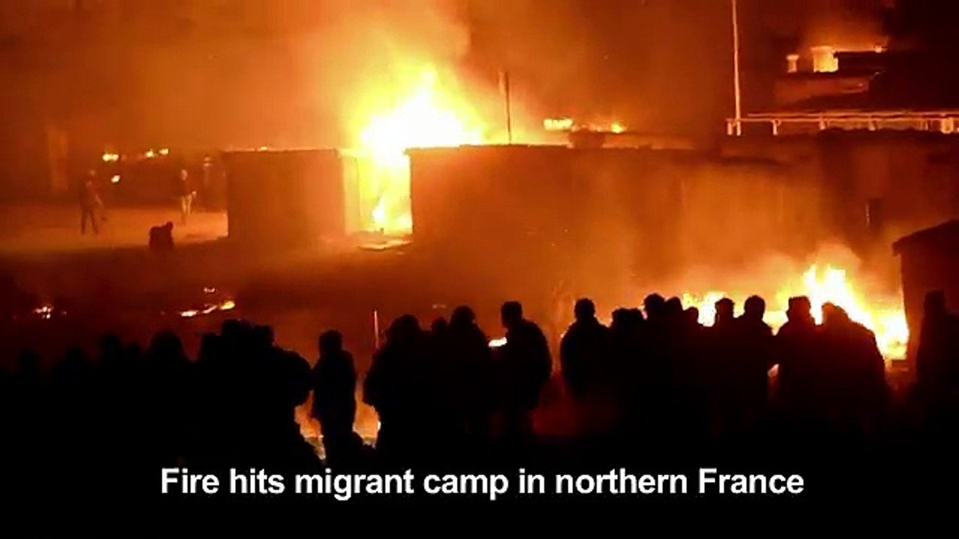 A huge fire tears through the Grande-Synthe migrant camp outside the northern French city of Dunkirk