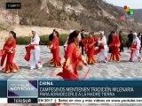 China mantiene viva la milenaria danza del tambor en la cintura