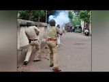 Vadodara demolition drive turns violent, protesters burn bus and a police chowky   Oneindia News