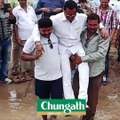 Odisha MLA lifted by supporters so his shoes don't get wet
