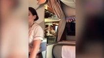 Sur la compagnie Emirates, une hôtesse surprise reversant du champagne d'un verre dans un bouteille
