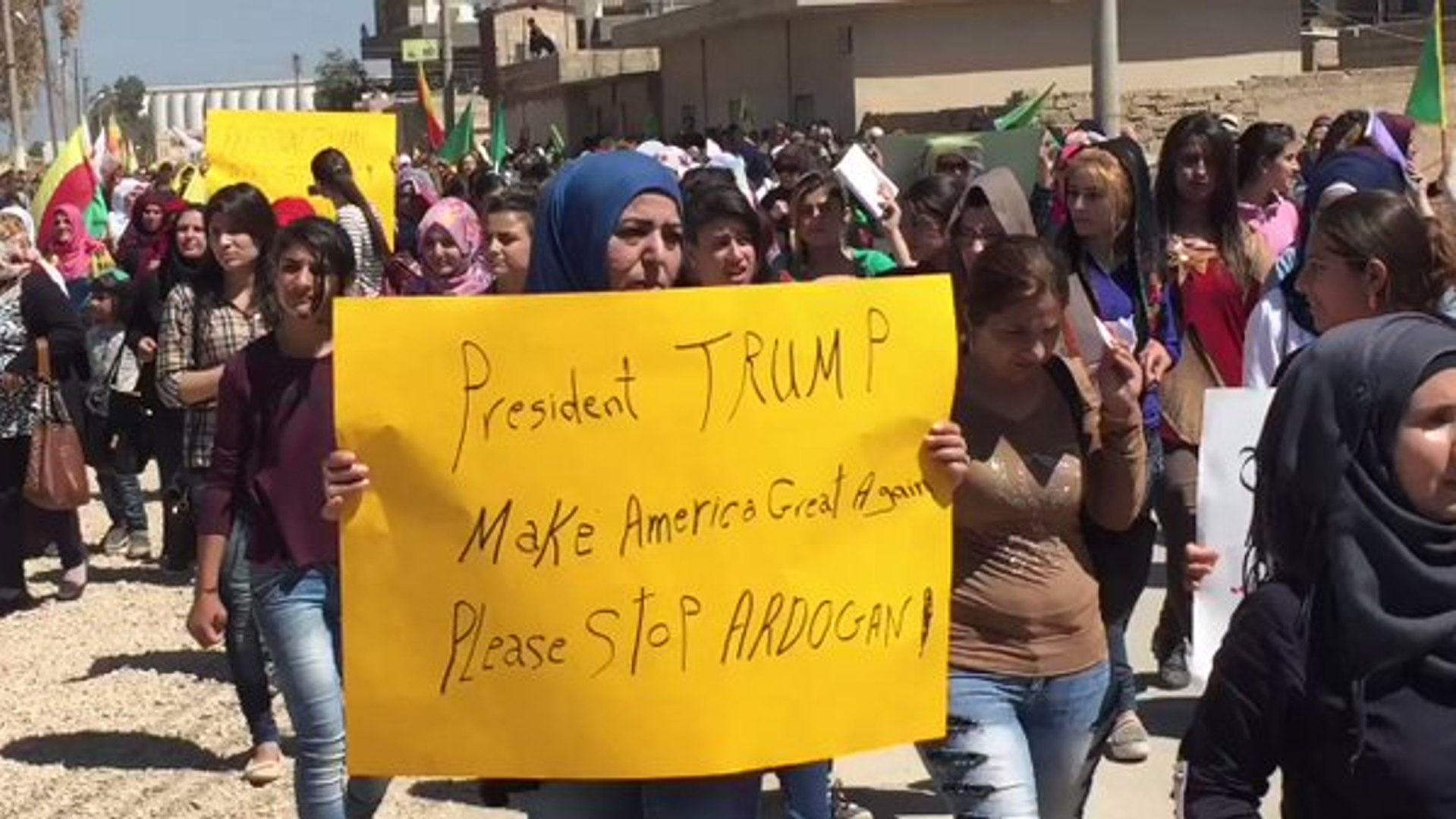 Signs Ask Donald Trump to Stop Erdogan at Protest Against Turkish Strikes
