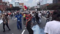 Protesters Toss Away Tear Gas Canisters Thrown by Venezuelan Police