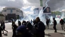Students in Paris throw smoke bombs and glass in protest