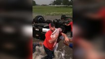 Texan 'hero' motorists rescue babies from overturned car in storm flood